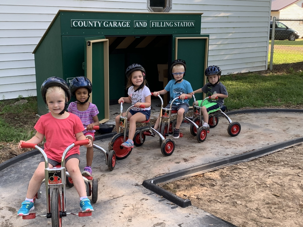 Pre School students enhancing their gross motor skills on the bike path