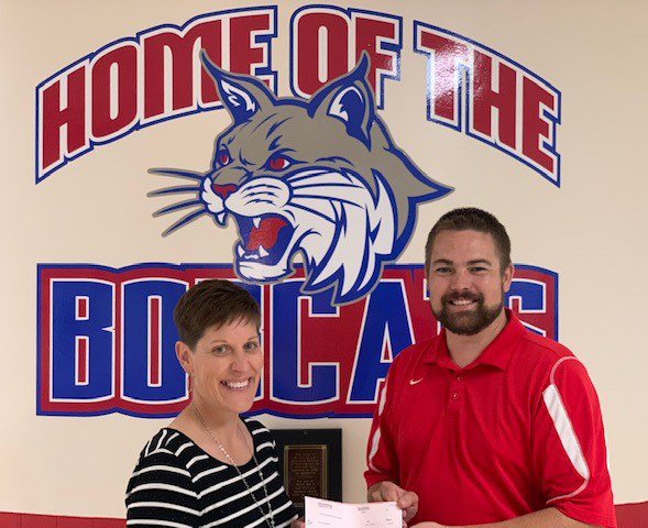 Mr. Deadmond presenting Mrs. Hanfland with her check.