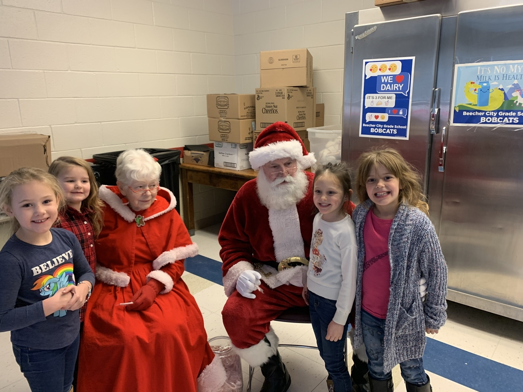 Mr. and Mrs. Santa Claus visited the grade school today